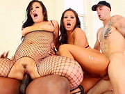 Clad in fishnets, big booty Asian supersluts London Keyes and Mena Mason fondle and lick each ...
